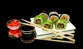 stock photo of soy sauce  - Japanese rolls soy sauce and pickled ginger on a black background - JPG