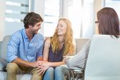 stock photo of psychologist  - Psychologist and happy couple in the office - JPG