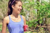 foto of cleanse  - Healthy Asian woman drinking fruit smoothie drink in outdoor forest park during summer - JPG