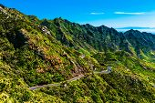 pic of canary  - Green mountains or rocks valley with winding road and sky nature landscape in Tenerife Canary island Spain at summer or spring