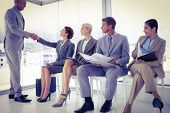 stock photo of interview  - Business people waiting to be called into interview at the office - JPG