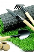 foto of blunt  - Small Gardening Tools and Artificial Turf Isolated on White Background. ** Note: Shallow depth of field - JPG