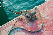 stock photo of bollard  - Bollard and rope on a commercial fishing pier - JPG