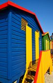 stock photo of beach hut  - Landscape with colorful changing huts on a beach in Muizenberg - JPG