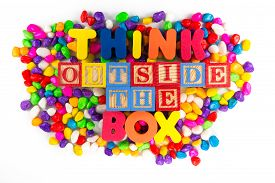stock photo of thinking outside box  - Think Outside The Box colorful word on the colorful stones  - JPG