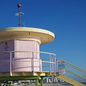 Pink art deco lifeguard tower closed up on beach in Miami, Florida, USA.