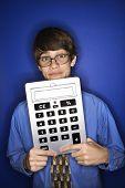 Portrait of Caucasian teen boy wearing eyeglasses and necktie holding oversized calculator.