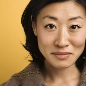 Close up portrait of mid adult Asian woman.