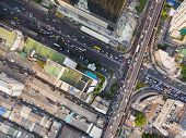 Aerial View Of Traffic Junction And Transportation Road In City, Top And Birdeyes View Shot 90 Degre poster