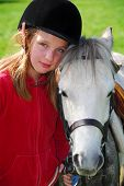 pic of horse riding  - portrait of a young girl with a white pony - JPG