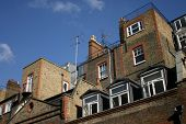 Brick Houses In London And Clouds Against A Blue Sky