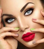 Beauty Fashion woman Portrait with Vivid Makeup and colorful Nail polish. Colourful nails. Beauty gi poster