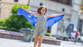 Eu Flag. Cute Happy Girl With The Flag Of The European Union. Young Teenage Girl Waving With The Eur poster