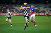 MELBOURNE - AUGUST 20 : Simon Black of Brisbane (R) and Dayne Beams of Collingwood contest a ball du