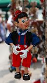 image of woodcarving  - Pinocchio is a fictional character that first appeared in 1883 in The Adventures of Pinocchio by Carlo Collodi and has since appeared in many adaptations of that story and others - JPG