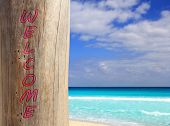 Caribbean tropical beach trunk with welcome word written [Photo Illustration]