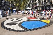 BARCELONA, SPAIN - AUGUST 16: Joan Miro's Pla de l'Os mosaic in La Rambla on August 16, 2011 in Barc