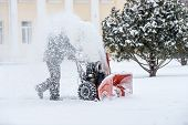 Snow-removal Work With A Snow Blower. Man Removing Snow. Heavy Precipitation And Snow Pile poster