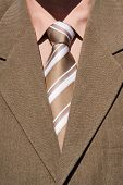 Brown Tie And Brown Suit
