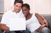 Couple watching DVD on laptop