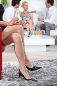 stock photo of swingers  - Party guests drinking champagne - JPG