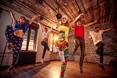 Young modern dancing group practice dancing in jump. Sport, dancing and urban culture concept poster