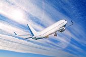 Airplane Flying In The Sky, Travel Background With Commercial Flying Airplane With Blank Livery. Air poster
