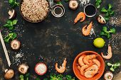 Frame With The Ingredients Of Asian Food. Crude Brown Rice,shrimps, Mushrooms. Copy Space, Top View. poster