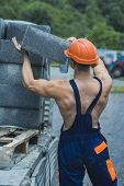 Sexy Builder Concept. Man Or Bodybuilder With Big Muscles. Guy Works At Construction Site. Muscular  poster