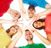 Happy Students In Colorful Clothing Standing Together Making Star With Their Fingers. poster