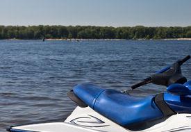 stock photo of waverunner  - Waverunner at the Volga river on shore background - JPG