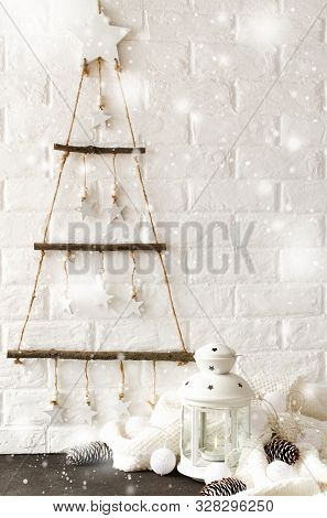 poster of Scandinavian Cozy Home Decor. Wooden Stylish Christmas Tree In Scandinavian Style Against The Backgr
