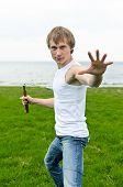 Martial Arts: Man With Nunchaku