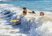 pic of papagayo  - boys have fun riding in the waves  - JPG