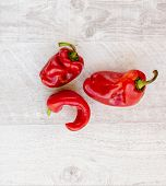 Trendy Ugly Organic Peppers On The Table. Ugly Food Concept, Ugly Shaped Organic Vegetables. poster