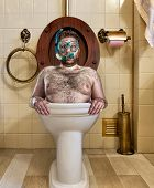 Bizarre man with goggles swimming in vintage toilet