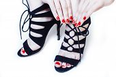 Fashion Concept People: Woman With Red Nails Manicure Pedicure Tying Shoelaces On Hight Heel Shoes I poster