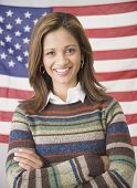 Indian woman in front of American flag