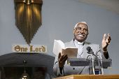 African American Reverend preaching in church