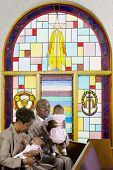 stock photo of piety  - African American family in church - JPG