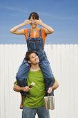 Woman sitting on boyfriend's shoulders