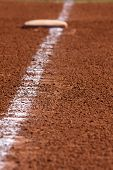 Chalk Line to First Base; focus on chalk line with base in background