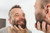 Man Looking At Beard In Mirror poster