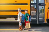 Two Funny Happy Caucasian Boys Students Kids In Sunglasses With Apples Near Yellow Bus On 1 Septembe poster