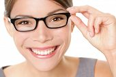 Eyewear glasses woman happy holding showing her new glasses smiling on white background. Beautiful y