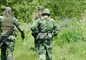 foto of hider  - Soldiers in protective clothes with the weapon - JPG