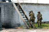picture of hider  - Soldiers in protective clothes with the weapon - JPG