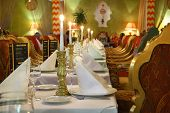 foto of indian food  - long table with serving and beautiful chairs in eastern luxury restaurant - JPG
