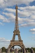 Very High Eiffel Tower Symbol Of Paris With Some White Clouds In The Blue Sky And The Cannons Of The poster