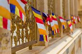 Buddhist Flag Is Commonly Used Internationally Is Called. Bunting Began To Appear To Be Used From Th poster